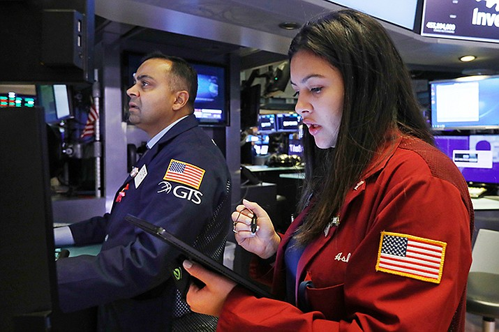 Specialist Dilip Patel, left, and trader Ashley Lara work on the floor of the New York Stock Exchange, Friday, Nov. 15, 2019. Stocks opened broadly higher on Wall Street as hopes continued to grow that the U.S. and China were moving closer to a deal on trade. (Richard Drew/AP)