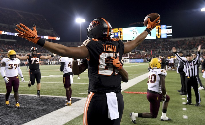 Oregon State tight end Noah Togiai celebrates after scoring a touchdown during the second half of a game against Arizona State in Corvallis, Ore., Saturday, Nov. 16, 2019. (Steve Dykes/AP)