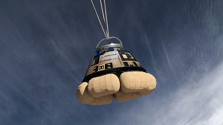 Boeing's CST-100 Starliner reusable space capsule parachutes back to earth during a test on Feb. 13, 2019. (Public domain)
