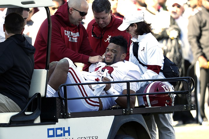 Alabama QB Tua Tagovailoa (13) is carted off the field after getting injured in a game against Mississippi State in Starkville, Miss., Saturday, Nov. 16, 2019. (Rogelio V. Solis/AP)