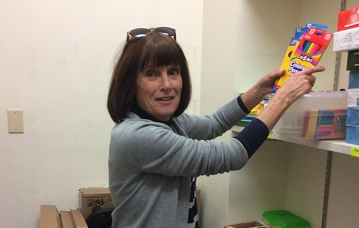 Prescott Unified Education Foundation board member Jane Robertson, a retired Abia Judd Elementary second-grade teacher, sifts through supplies in the Teachers' Closet in the Family Resource Center in the Washington School District Office. (Nanci Hutson/Courier)