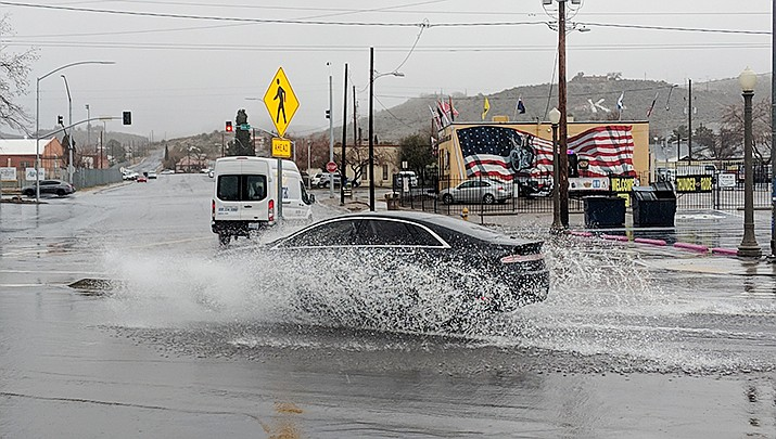"Clay Morgan, senior forecaster at the National Weather Service in Las Vegas, says now that the ""wet season"" is here, people should double-check their tires and wiper blades. (Photo by Travis Rains/Miner)"