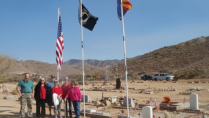 Some of the volunteers who worked to replace and replenish flags for veterans in the Chloride Cemetery are shown above. (Courtesy photo)
