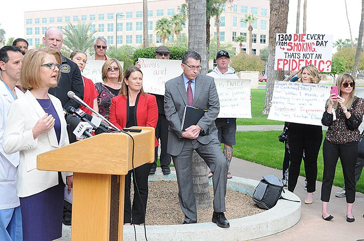 Sen. Heather Carter, speaking, on the left, discusses, with reporters, her proposed legislation earlier this month to regulate vaping products like tobacco. Carter, along with the rest of the Arizona legislature, will be asked to not only spend a huge budget surplus this year, but also tackle a number of social issues. (Capitol Media Services photo by Howard Fischer)