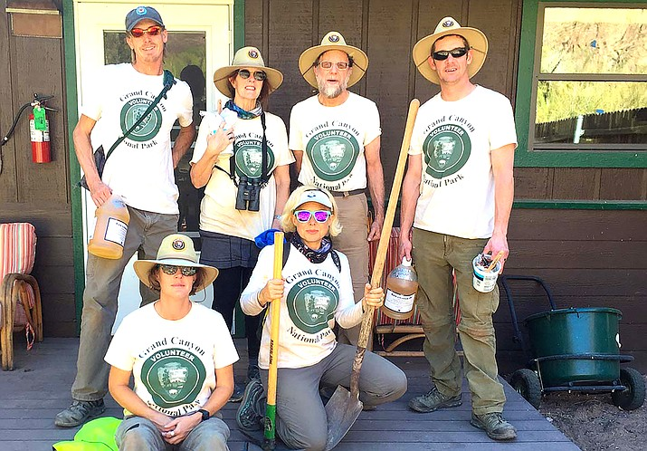Six volunteers with Grand Canyon Hikers & Backpackers Association pose for a photo wearing National Park Service Volunteer hats and shirts. (Photo/NPS)