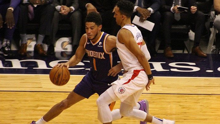 Devin Booker had 30 points, eight assists and five rebounds in a 120-116 loss to Sacramento on Tuesday night. (Miner file photo)