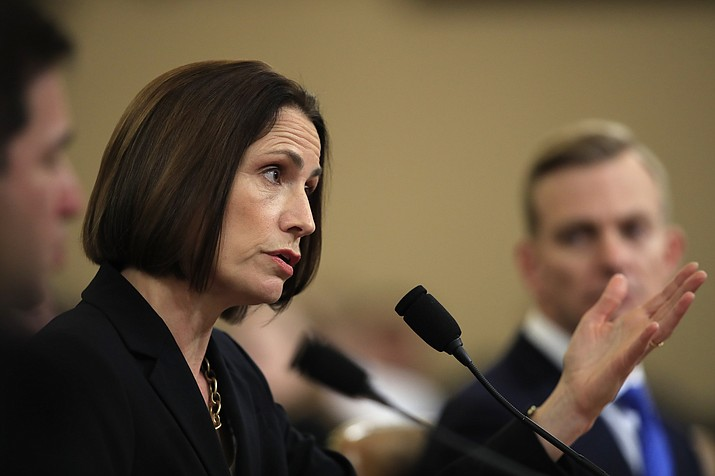 Former White House national security aide Fiona Hill, and David Holmes, a U.S. diplomat in Ukraine, right, testify before the House Intelligence Committee on Capitol Hill in Washington, Thursday, Nov. 21, 2019, during a public impeachment hearing of President Donald Trump's efforts to tie U.S. aid for Ukraine to investigations of his political opponents. (AP Photo/Manuel Balce Ceneta)
