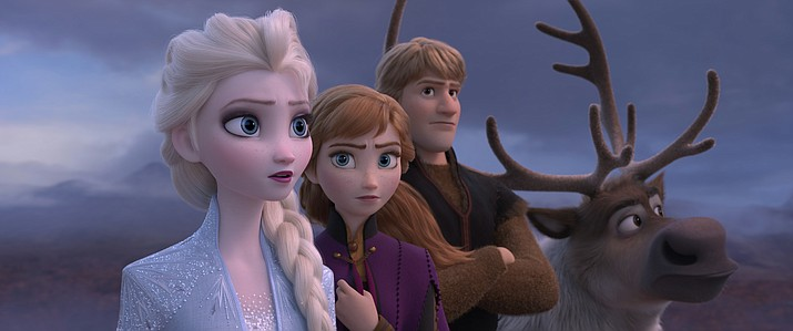 """This image released by Disney shows Elsa, voiced by Idina Menzel, from left, Anna, voiced by Kristen Bell, Kristoff, voiced by Jonathan Groff and Sven in a scene from """"Frozen 2."""" (Disney via AP)"""