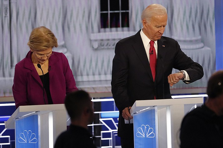Democratic presidential candidate Sen. Elizabeth Warren, D-Mass., left, and Democratic presidential candidate former Vice President Joe Biden during a commercial break in a Democratic presidential primary debate, Wednesday, Nov. 20, 2019, in Atlanta. (John Bazemore/AP)