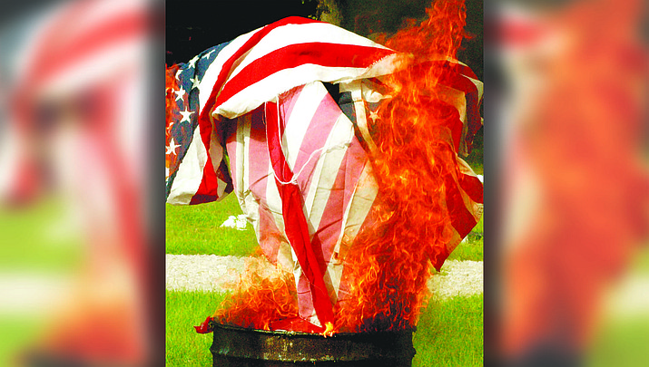 """Numerous veterans organizations """"retire"""" old American flags by burning them in formal retirement ceremonies. (Adobe Image)"""