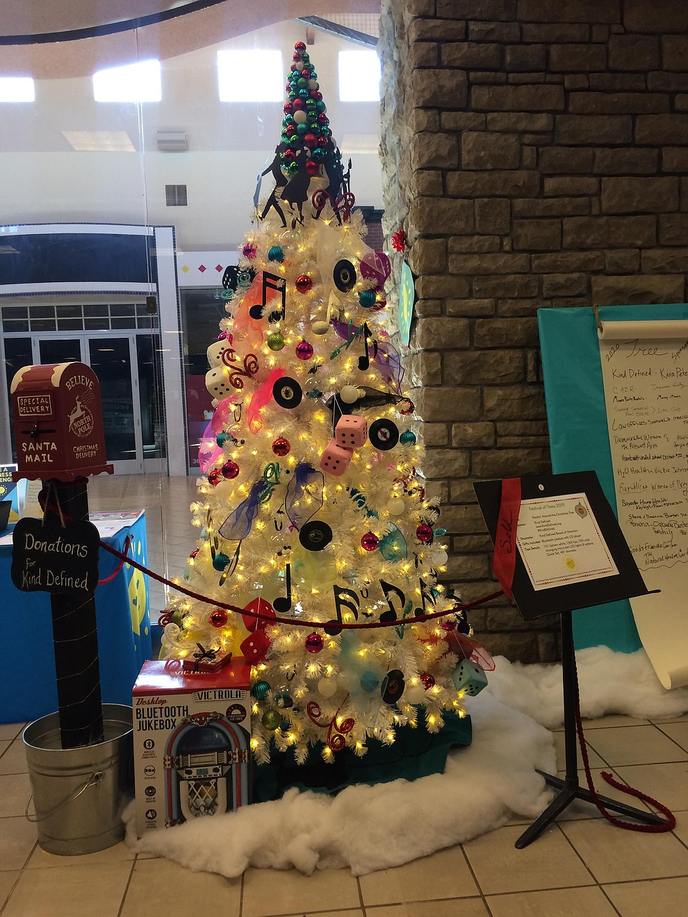 """Rockin' Around the Christmas Tree,"" sponsored by Kind Defined  and decorated by the Kind Defined Board of Directors found at the Festival of Trees 2019 at Prescott Gateway Mall from Wednesday, Nov. 20 through Saturday, Nov. 23. (Jason Wheeler/Courier)"