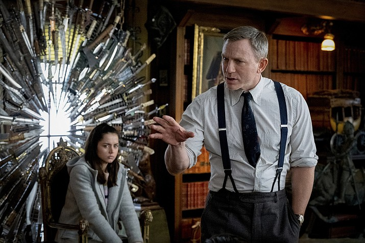 "This image released by Lionsgate shows Ana de Armas, left, and Daniel Craig in a scene from ""Knives Out."" (Claire Folger/Lionsgate via AP)"
