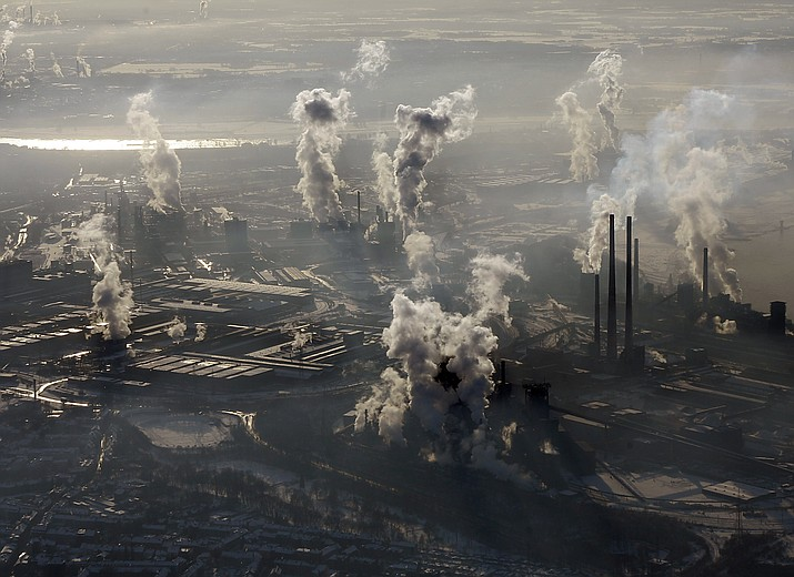 In this Jan. 9, 2009 photo is an aerial view of the steel company ThyssenKrupp in Duisburg, western Germany. Inger Andersen, head of the U.N. Environment Program, says the world needs 'quick wins to reduce emissions as much as possible in 2020.' Ahead of a global climate summit in Madrid next week, her agency published a report Tuesday showing the amount of planet-heating gases released into the atmosphere hitting a new high last year. (Frank Augstein/AP,file)
