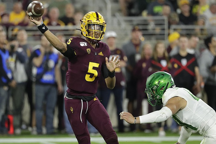 Arizona State quarterback Jayden Daniels throws under pressure from Oregon linebacker Isaac Slade-Matautia during the second half of an NCAA college football game Nov. 23 in Tempe, Ariz. Arizona State won 31-28. (AP Photo/Matt York)