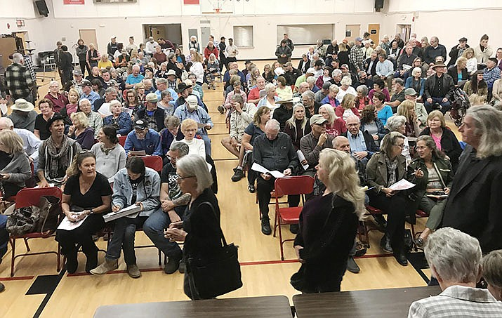 More than 250 people came to a Nov. 12 Cornville Community Association meeting where area residents voiced opposition to the size and scope of two large planned area developments. Lisa Borowsky, speaking for the applicant for the Spring Creek Ranch development seeking a zoning change, took questions from the Verde News. VVN/Jason W. Brooks