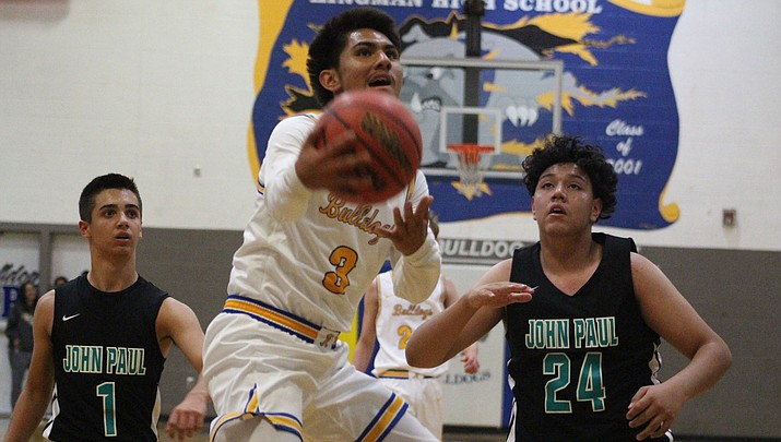 Gabe Imus scored a game-high 16 points Monday night as Kingman picked up a convincing 70-36 victory over St. John Paul. (Photo by Beau Bearden/Kingman Miner)