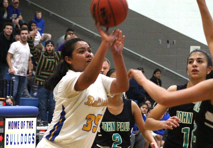 Star Talayumpteua scored 12 of her team-high 18 points in the second half Monday in Kingman's 58-37 loss to St. John Paul. (Photo by Beau Bearden/Kingman Miner)