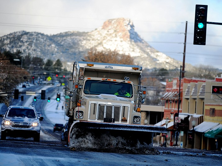 City of Prescott snow plow hits the intersection of Montezuma and Gurley streets in 2015. The National Weather Service is predicting the Prescott area could see anywhere from 15 to 27 inches of snow Thursday and Friday, Feb. 21 and 22. Visit dCourier.com for updates today on the winter storm. (Courier file photo)