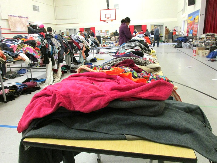 Tables covered in clothing fill half of the high school gym Nov. 23. Volunteers arrived early the day before to help set up. (Abigail Kessler/WGCN)