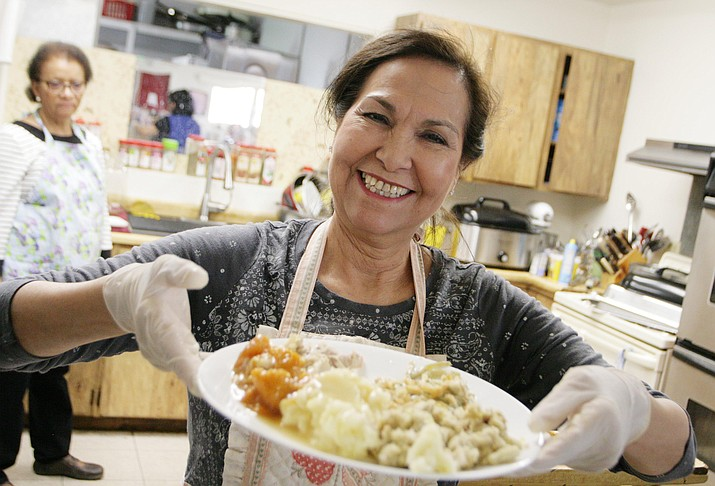 Dora Alicia Trinidad shows what a delicious plate of food looks like at the Nov. 22 meal. VVN/Bill Helm.