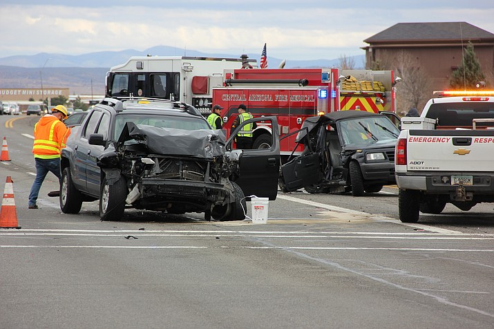 Vehicles sit heavily damaged in the intersection of Highway 69 and Navajo Dr. in Prescott Valley after a 5-vehicle crash Wednesday afternoon, Nov. 27, 2019. The collision was allegedly caused by a Prescott Valley woman who police said was impaired and excessively speeding. (Max Efrein/Courier)