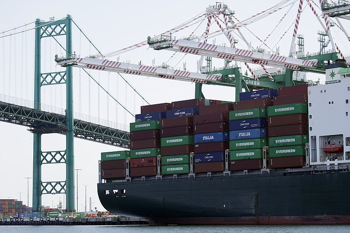 FILE - In this June 19, 2019, file photo a cargo ship is docked at the Port of Los Angeles in Los Angeles. On Wednesday, Nov. 27, the Commerce Department issues the second estimate of how the U.S. economy performed in the July-September quarter. (AP Photo/Marcio Jose Sanchez, File)