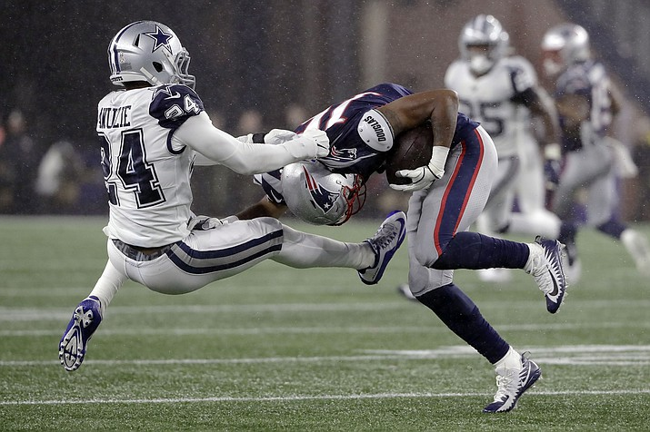 Dallas Cowboys cornerback Chidobe Awuzie, left, tries to tackle New England Patriots wide receiver Jakobi Meyers in the first half of a game, Sunday, Nov. 24, 2019, in Foxborough, Mass. (Steven Senne/AP)