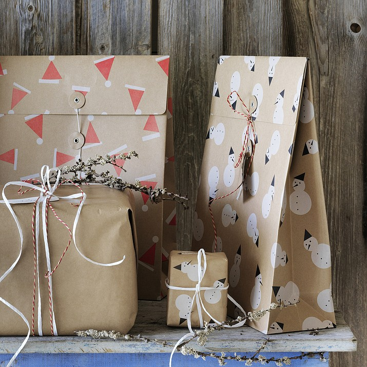 This photo provided by IKEA shows its Vinter Gift Bags. The tins are a good alternative to traditional gift wrapping. (IKEA via AP)