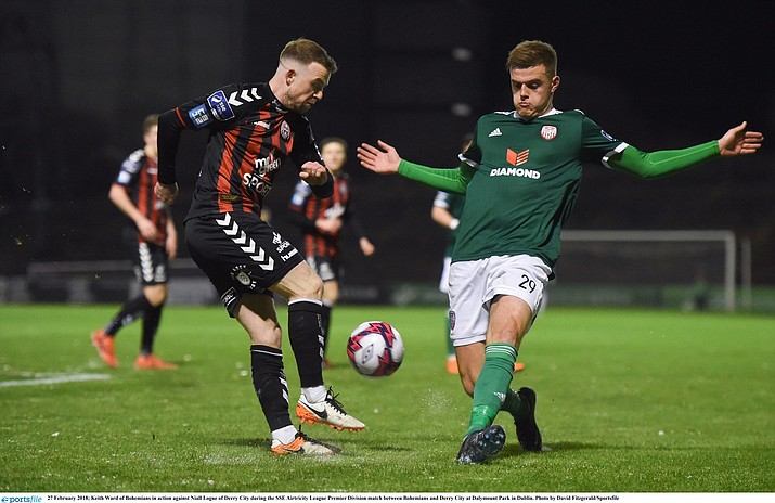 Irish professional soccer player Naill Logue on the field (right in green shirt). (Armed to Know/Courtesy)