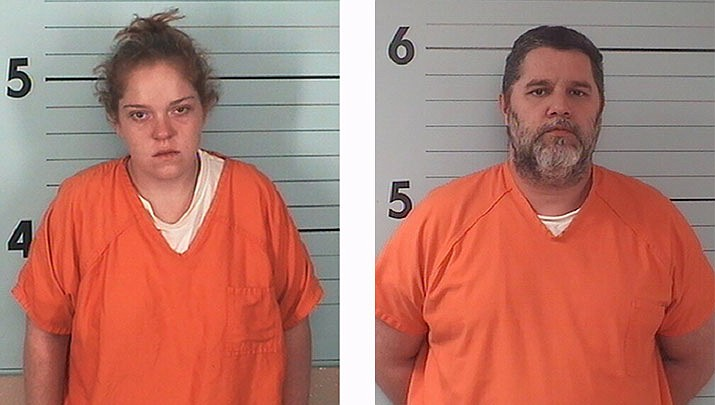 This undated booking photo provided by the Burke County, N.C., Sheriff's Office shows Callie Elizabeth Carswell (left), who's charged with armed robbery, misuse of 911 and filing a false police report and Clarence William Moore III (right), who's charged with armed robbery. Police say the two staged a robbery at the business Monday, bought rings hours later and took video of their engagement at a Walmart. (Burke County Sheriff's Office via AP)