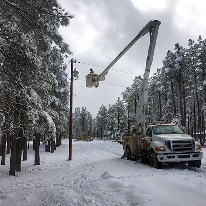 An Arizona Public Service (APS) crew repairs a telephone pole after a winter storm that swept through northern Arizona Friday, Nov. 29, 2019. (APS/Courtesy)