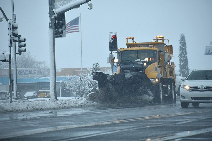 A snowplow makes its way down Highway 69 in Prescott Valley on Friday, Nov. 29, 2019. The quad-city area was hit by a winter snowstorm late Thanksgiving night and most of the day Friday, slowing traffic. (Richard Haddad/WNI)