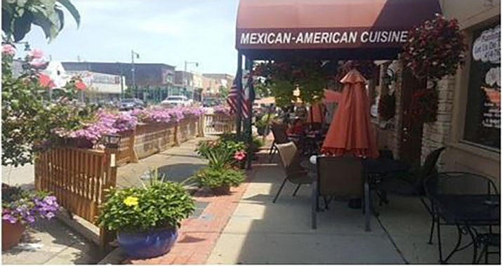 A pedlet, an extension of the curb to allow for curbside dining and landscaping, is shown in this photo provided by the City of Kingman. City Countil will consider a pilot program to allow pedlets and similar extensions in front of businesses in downtown Kingman. (Courtesy photo)