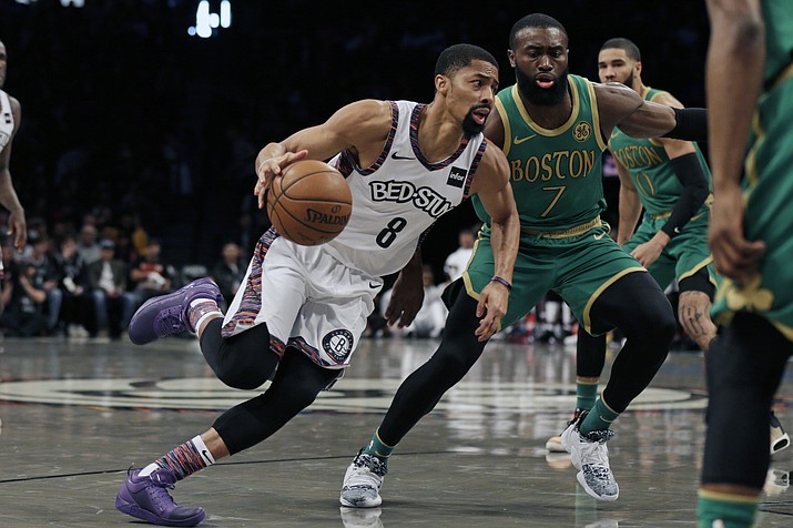 Brooklyn Nets guard Spencer Dinwiddie (8) drives to the basket past Boston Celtics guard Jaylen Brown (7) during the first half of a game Friday, Nov. 29, 2019, in New York. (Adam Hunger/AP)