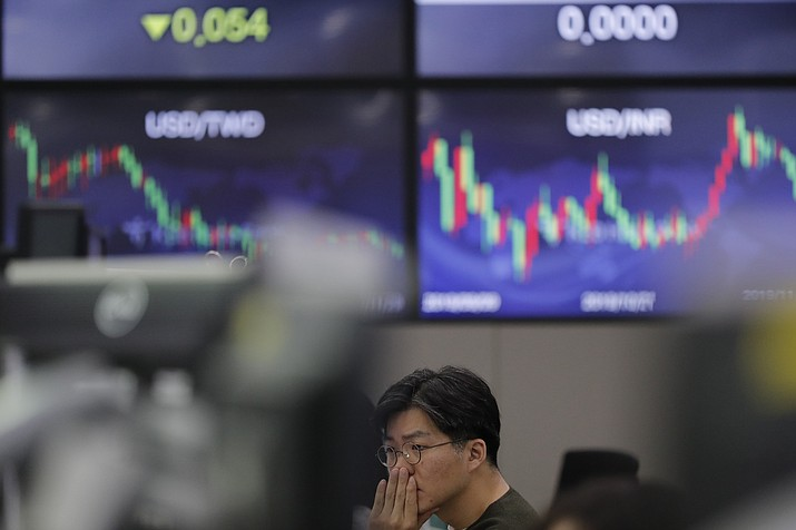 A currency trader watches computer monitors at the foreign exchange dealing room in Seoul, South Korea, Friday. (Lee Jin-man/AP)