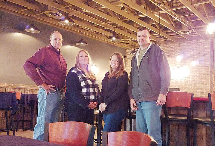 From left, Richard Ross, Gretchen Ross, Mercy Clark and Kyle Ross will be opening the new Iron Cask restaurant where the former Native Grill & Wings had been located in the Crossroads shopping center south of Highway 69 in Prescott Valley. (Doug Cook/Courier)