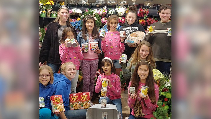 The Fancy Feathers and Furs 4H Club of Kingman poses at Smith's Food and Drug.(Courtesy photo)