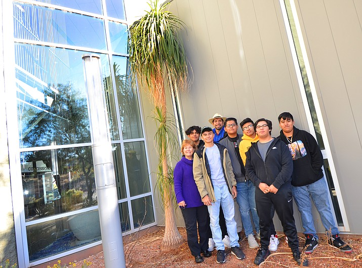 The ponytail palm is pictured before it was uprooted with: Left to right, former Red Rock High school librarian Elaine Vail, students Eduardo Flores Jr., Fransisco Bekele, Devin Nez, Kevin Arenas-Buno, Ramiro Alvarez, Angel Lopez-Rogue and JoeVillegasin the back in the hat. VVN/Vyto Starinskas