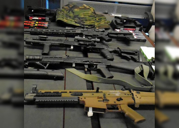 Pictured are five rifles, two handguns, ammunition and body armor seized from a vehicle attempting to cross into Mexico from Arizona on Nov. 14, 2017. (Customs and Border Protection)
