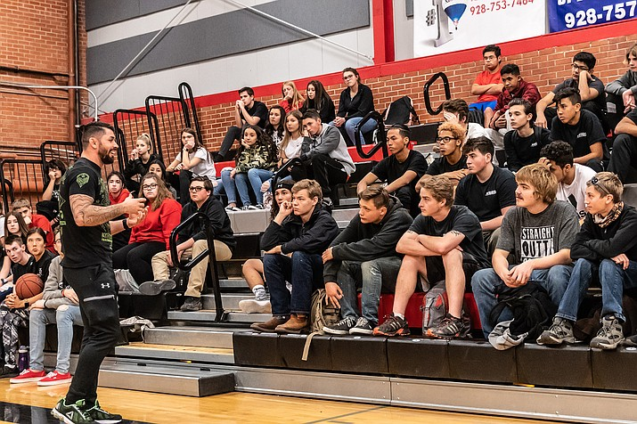 Brian Skinner, a teacher of Muay Thai kickboxing, mixed martial arts, boxing, grappling and other martial-arts oriented fitness classes, speaks to students at Lee Williams High School about bullying in January 2019. (Photo by Michael Chan/For The Miner)