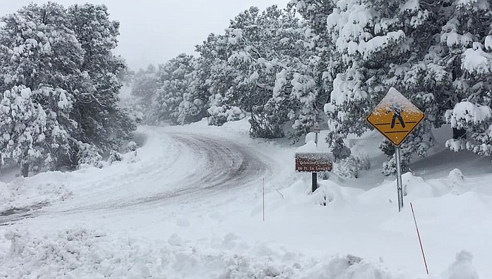 The winter storm in the Grand Canyon area has forced the town of Tusayan to declare an emergency. This photo shows a road in Grand Canyon National Park. (Public domain)