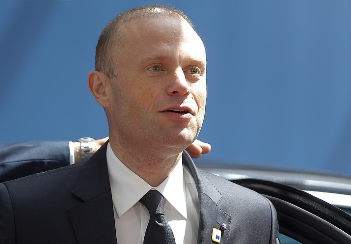 In this Thursday, June 20, 2019 file photo, Malta's Prime Minister Joseph Muscat arrives for an EU summit at the Europa building in Brussels. Maltese Prime Minister Joseph Muscat said Sunday Dec. 1, 2019, that he would resign in January following pressure from citizens for the truth about the 2017 car bombing that killed a journalist. (Julien Warnand/Pool via AP, File)