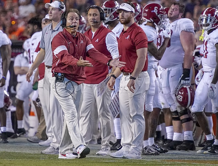 Alabama head coach Nick Saban disagrees with a call in the second half of an NCAA college football game against Auburn in Auburn, Ala., on Saturday, Nov. 30, 2019. Alabama dropped to No. 9 in The Associated Press college football poll, snapping the Crimson Tide's record streak of 68 appearances in the top five. (Chris Shimek/The Decatur Daily via AP)