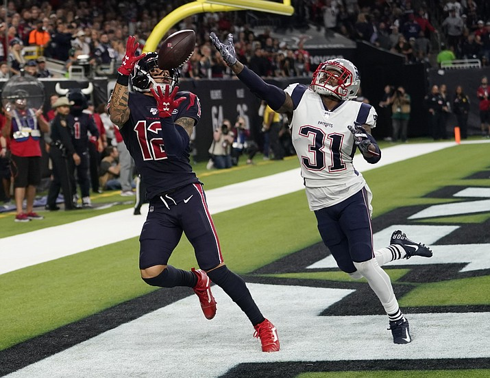 Houston Texans wide receiver Kenny Stills (12) pulls in a pass in front of New England Patriots cornerback Jonathan Jones (31) for a touchdown during the second half of an NFL football game Sunday, Dec. 1, 2019, in Houston. (David J. Phillip/AP)