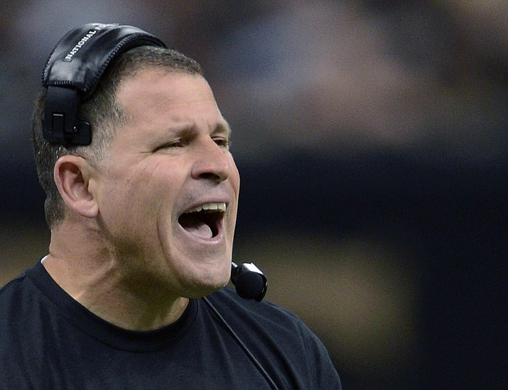 In this Dec. 29, 2013, file photo, then-Tampa Bay Buccaneers head coach Greg Schiano reacts on the sideline in the first half of an NFL football game against the New Orleans Saints in New Orleans. Greg Schiano is coming back to Rutgers. Athletic director Pat Hobbs announced Sunday, Dec. 1, 2019 the university and Schiano have reached a contract agreement, a week after talks to bring back the 53-year-old former Scarlet Knights head coach fell apart. (AP Photo/Bill Feig, File)