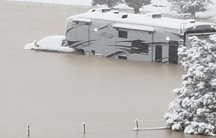 When deputies arrived, three adults were trapped as water had surrounded the truck and fifth wheel trailer and was approximately 4-feet to 5-feet deep. Photo courtesy Yavapai County Sheriff's Office