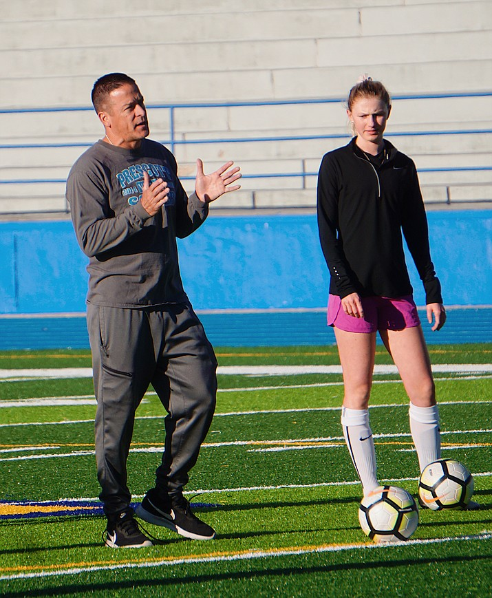 Prescott girls soccer head coach Paul Campuzano gives out instructions for a drill at the team's practice on Tuesday, Nov. 26, 2019, in Prescott. (Aaron Valdez/Courier)