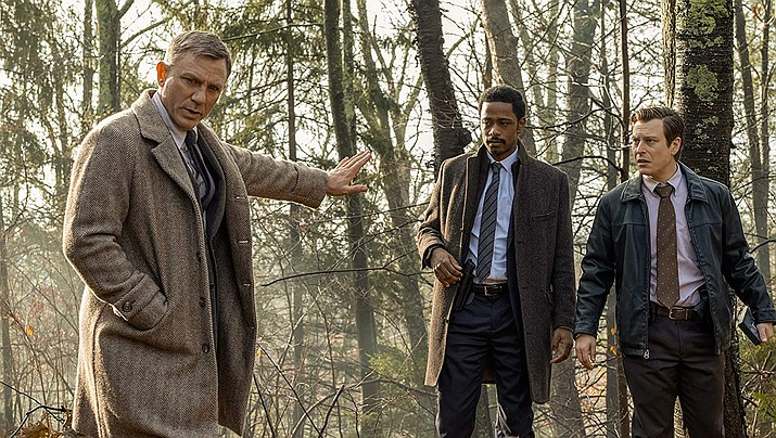 From left, Daniel Craig, Noah Segan and LaKeith Stanfield are shown in Knives Out.