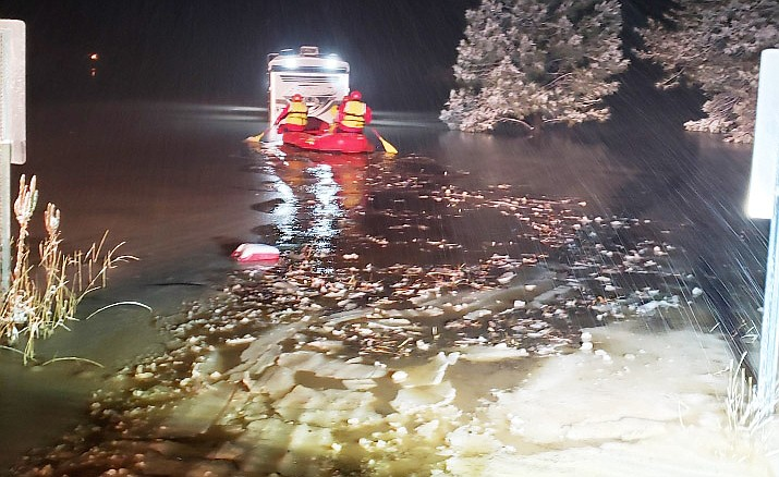 The Copper Canyon Fire water rescue team paddle out to a truck and trailer that got flooded in Camp Verde Friday morning, Nov. 29, 2019. (YCSO/Courtesy)
