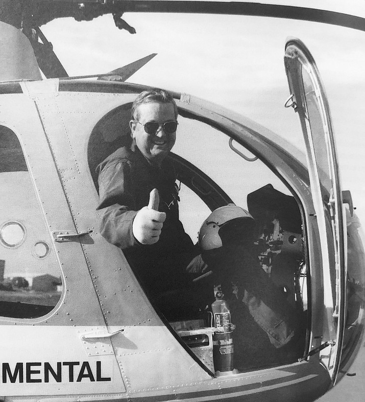 Harry Robertson gives a thumbs up after successfully completing a crashworthy fuel system flight test program in 1990. (photo/Harry Robertson)